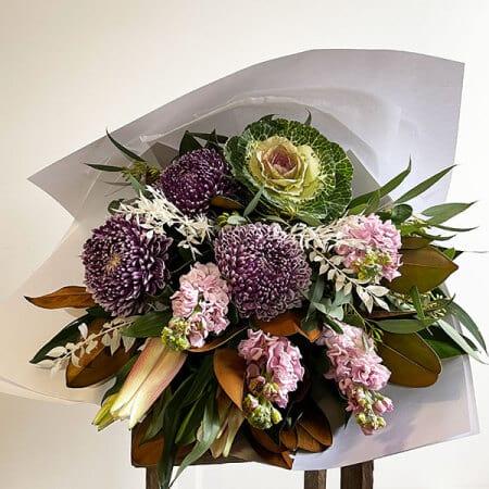 purple kale lily bouquet