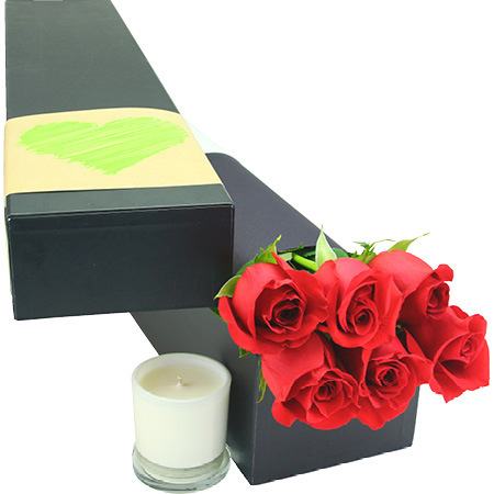 Red roses with scented candle