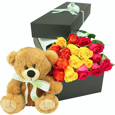 Teddy Bear with bright roses