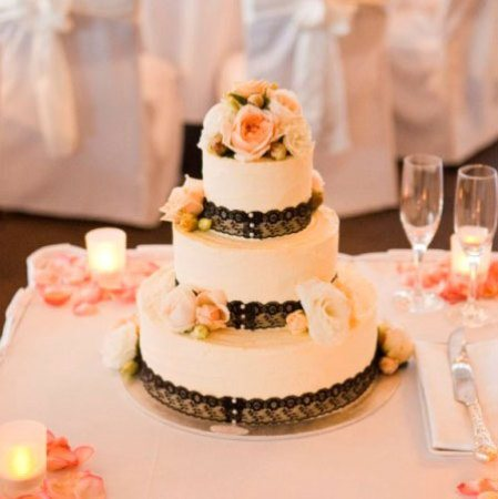 Three Tier Cake with Apricot & Ivory Flowers & Black Lace Trim