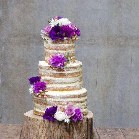 Semi naked wedding cake with purple white flowers three tier semi naked cake with purple white flowers mightylinksfo
