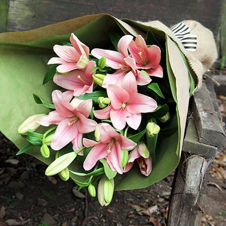 gift wrapped lily bouquet flowers delivered