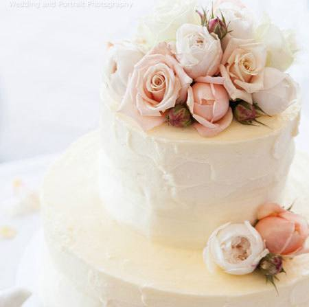 Two Tier Wedding Cake with Pale Peach & Ivory Flowers