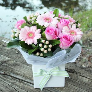 pink flower arrangement in box