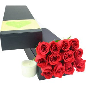 Classic red roses with candle
