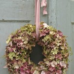 A divine hydrangea wreath in pinks and greens, so romantic! Online florists Australia.