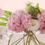 Spherical vase of pink and white flowers