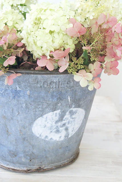 Rustic pail of flowers