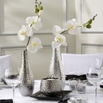 Metallic silver bottle shaped vases perfect for single stems, such as these elegant orchids.
